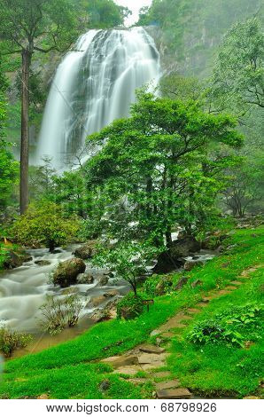 Waterfall With A Pathway In Green Garden At Khlong Lan Waterfall