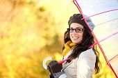 stock photo of rainy season  - Fashionable woman holding umbrella on rainy cold autunm day - JPG