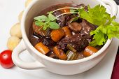 picture of boeuf  - Boeuf bourguignon with carrots onions and mushrooms - JPG