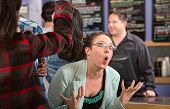 pic of patron  - Emotional white female customer in line at coffee house - JPG