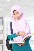 picture of muslim kids  - Muslim kid student reading something on book  - JPG