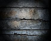 picture of dimples  - Dark and old and disintegrating concrete wall - JPG