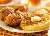 stock photo of southern fried chicken  - fried chicken and waffles shot in panoramic format - JPG