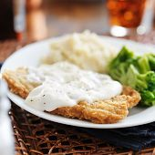 stock photo of southern fried chicken  - chicken fried steak with southern style peppered milk gravy - JPG
