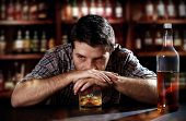 foto of liquor bottle  - lonely young alcoholic drunk man depressed - JPG