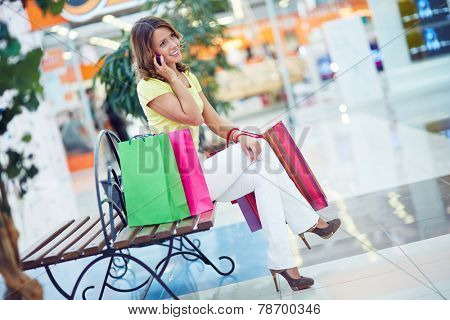 Female shopper speaking on cellphone in department store