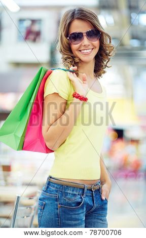 Female shopaholic in stylish casual-wear and sunglasses