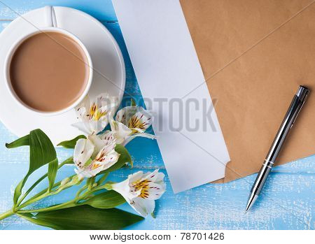 Cup Of Coffee With Milk, Blank Paper In The Envelope, Pen And Alstroemeria Flowers