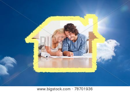 Happy couple organizing their new home against bright blue sky with clouds