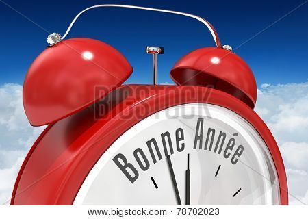 Bonne annee in red alarm clock against bright blue sky over clouds