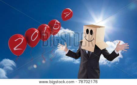 Anonymous businessman with hands out against bright blue sky with clouds