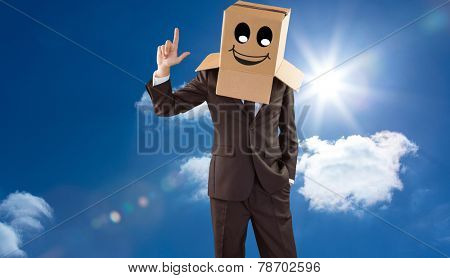 Anonymous businessman pointing up with finger against bright blue sky with clouds
