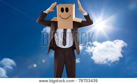 Anonymous businessman gesturing with hands against bright blue sky with clouds