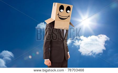 Anonymous businessman with hands down against bright blue sky with clouds