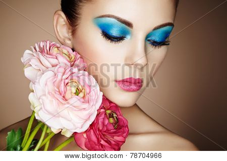 Portrait Of Beautiful Young Woman With Flowers