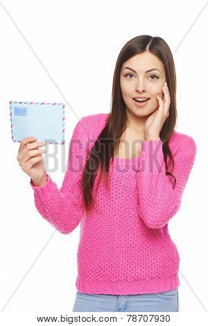Surprised woman with envelope
