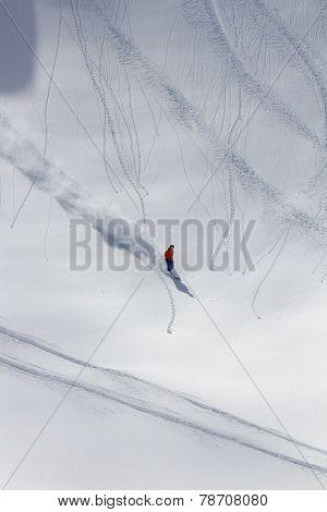 Skier in deep powder, extreme mountain freeride