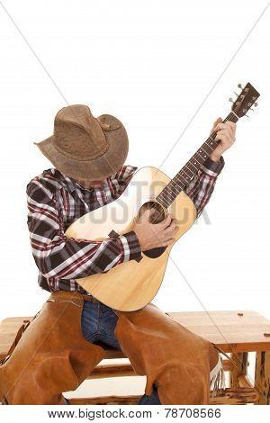 Cowboy Play Guitar Looking Down