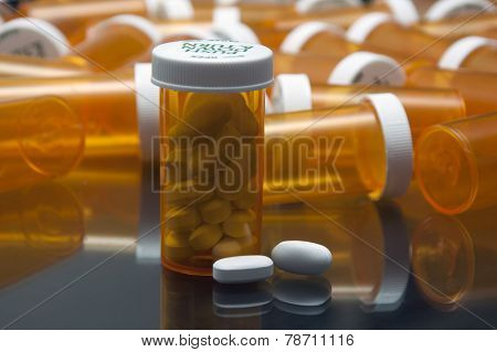 RX prescription vial and white pills