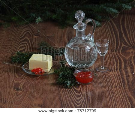 Still-life with red caviar and vodka and fur-tree branches