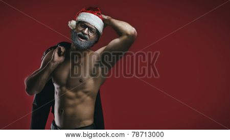Cheerful Shirtless Santa On Red Backgrouund