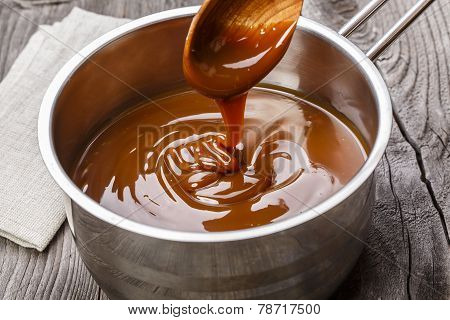 liquid caramel is poured into a gravy boat