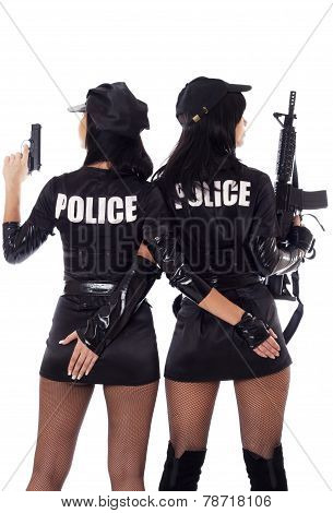 Two Sexy Women In Police Uniform.