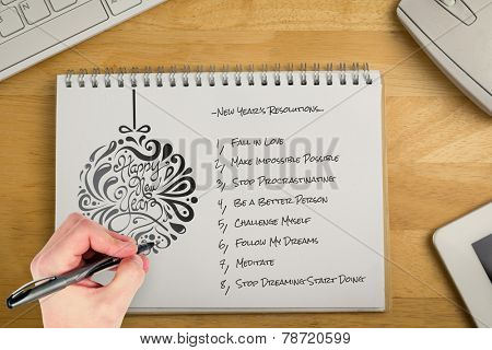 Hand writing with a pen against overhead of notepad and technology