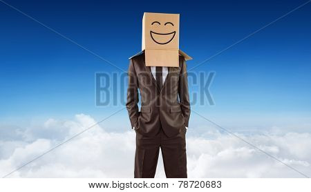 Anonymous businessman with hands in pockets against blue sky over clouds