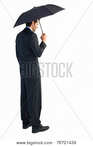 Rear view of classy businessman holding black umbrella on white background