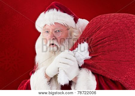 Santa takes care about his sack against red background