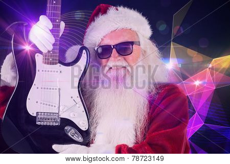 Father Christmas shows a guitar against digitally generated music symbol design