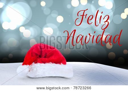 Feliz navidad against shimmering light design over boards