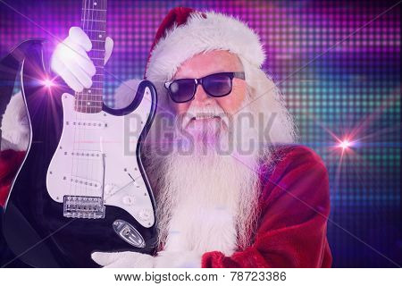 Father Christmas shows a guitar against digitally generated cool disco background