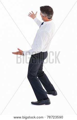 Businessman without his jacket posing with arms out on white background