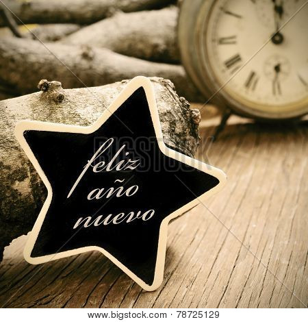 the sentence feliz ano nuevo, happy new year in spanish, written in a star-shaped chalkboard, on a rustic wooden surface, with an old watch in the background, in sepia tone