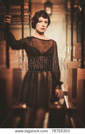 Vintage style young woman inside retro train coach