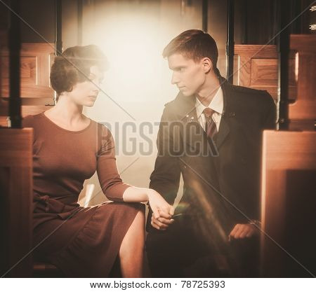 Vintage style couple inside retro train coach