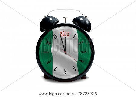 2015 in black alarm clock against digitally generated nigerian national flag