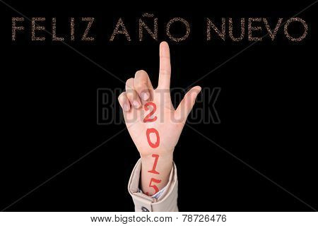 Businesswoman pointing against glittering feliz ano nuevo