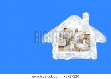 Family unpacking cardboard box against blue vignette