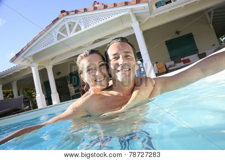 Couple embracing in private swimming pool