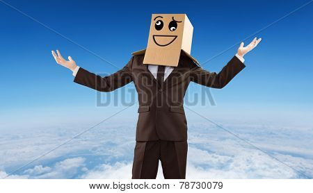 Anonymous businessman holding his hands out against blue sky over white clouds