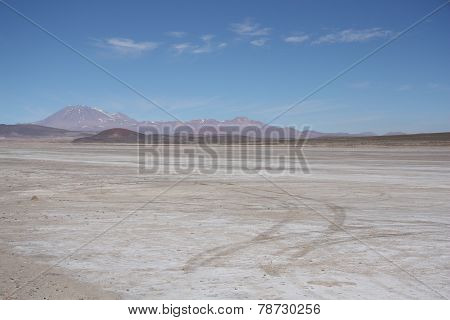 Stone desert with a trace of a car