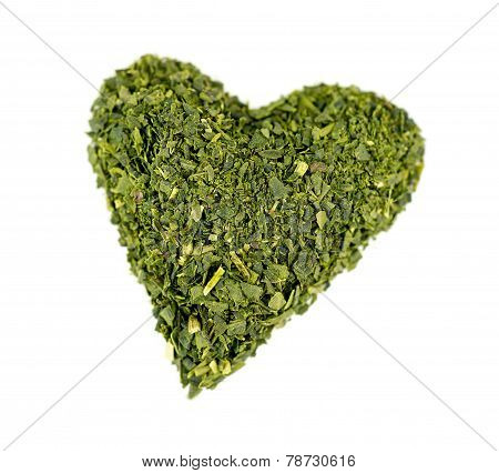 Macro Of Green Superfood Tea Isolated On White Background