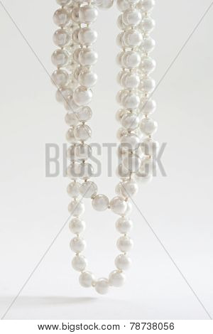 String Of Pearls On White