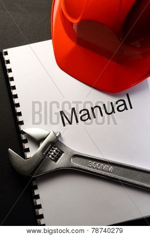 Manual With Helmet And Spanner