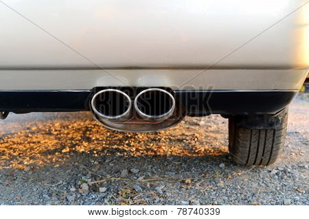 exhaust pipe of a silver gold car for carbon dioxide emissions