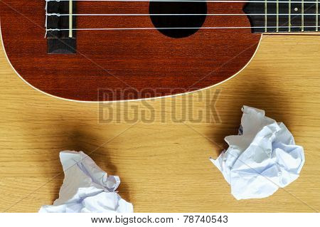 Ukulele Guitar With Paper Scraps