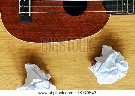 Ukulele Guitar With Paper Scraps
